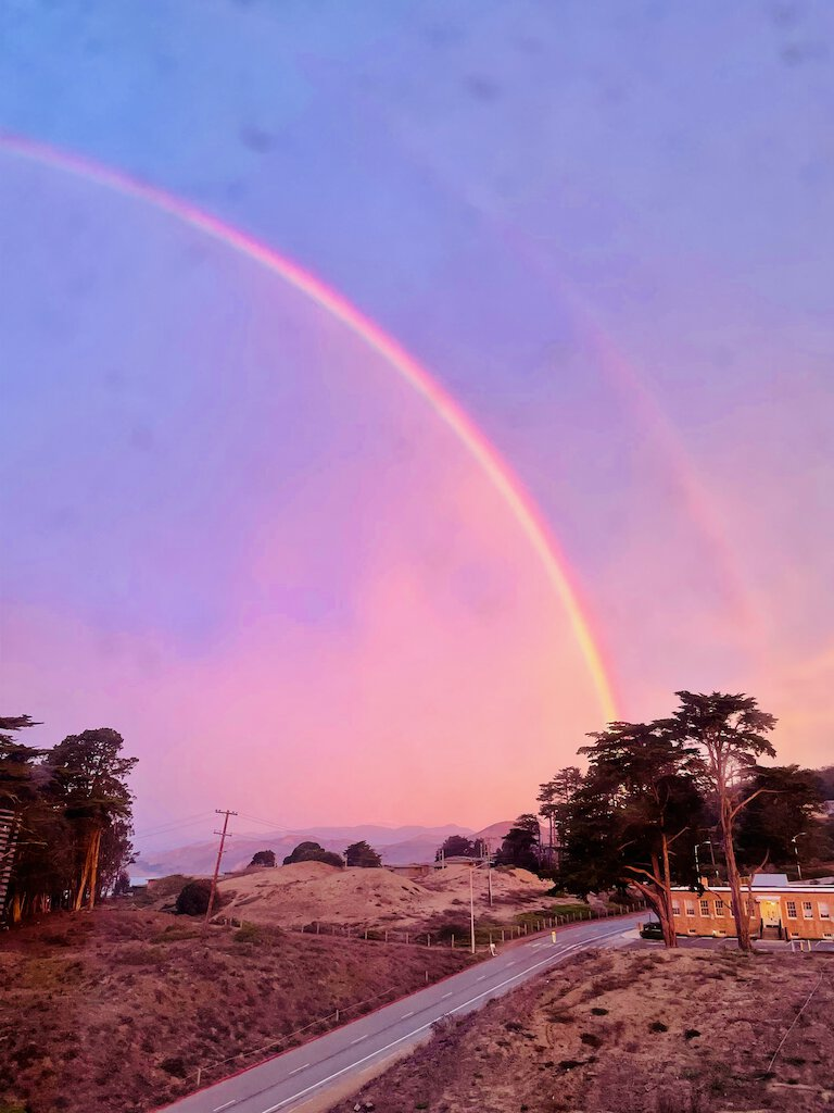 double rainbow and sunrise view from our bedroom window