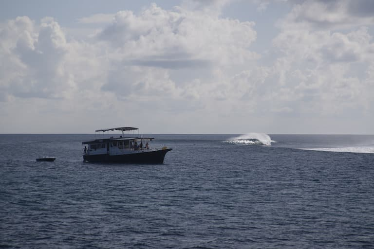 boat in front of wave