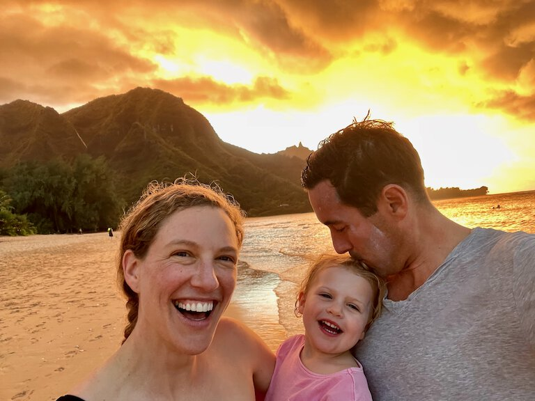 john, sierra, and stella enjoying the sunset at tunnels beach