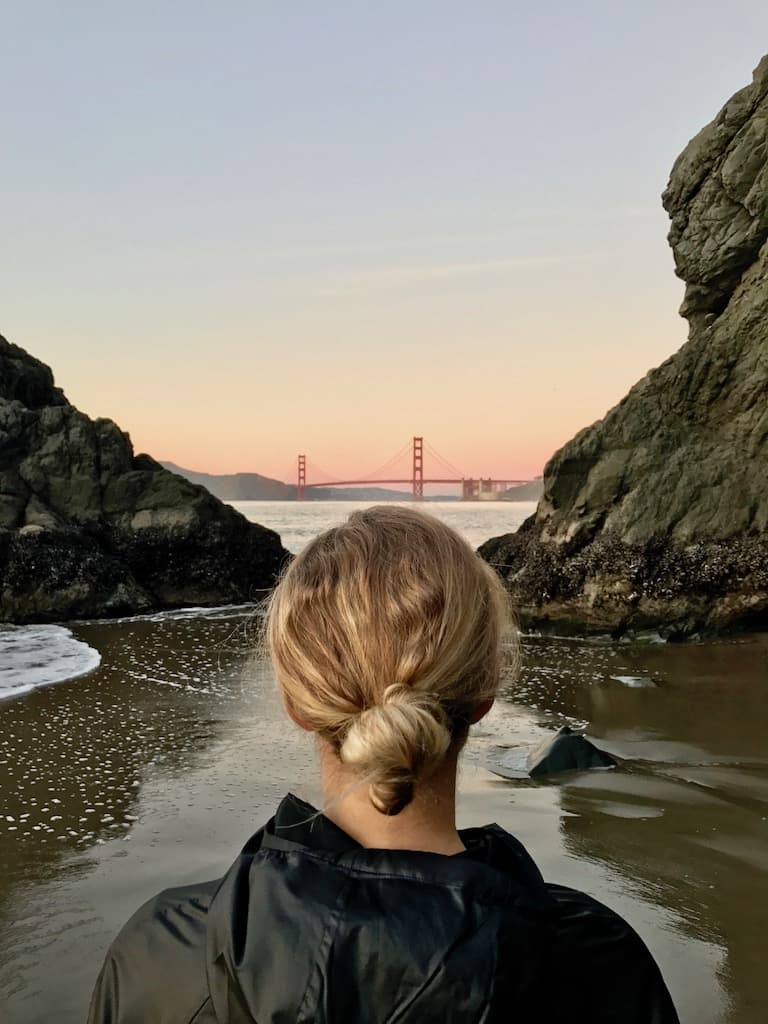 low tide sunset looking at golden gate bridge