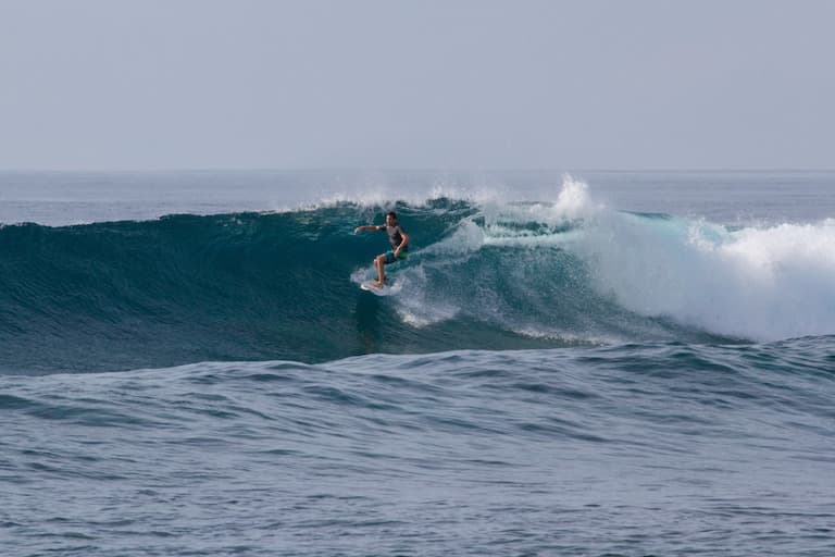 me surfing in maldives