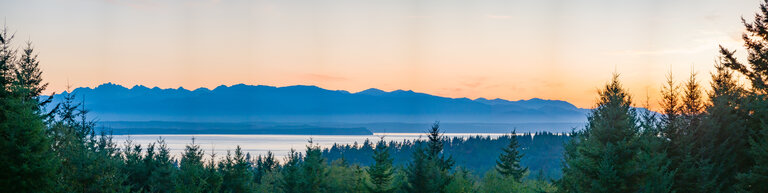 view of the sunset over the olympic pensinula from whidbey island